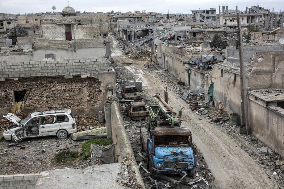 HOLD FOR ISLAMIC STATE-FOG OF WAR BY VIVIAN SALAMA FILE - In this In this Friday, Jan. 30, 2015 file photo, rubble and damaged buildings are seen in the devastated Syrian city of Kobani. While Islamic State fighters have been forced to retreat from Kobani, the strategic town on Syria's border with Turkey, they appear far from beaten in northern Iraq. Along the Kurds' shifting front lines, it's a tenuous hold. Whichever side triumphs will determine whether Islamic State can use the main highway west to funnel weapons and reinforcements to their retreating comrades in Syria. (AP Photo, File)