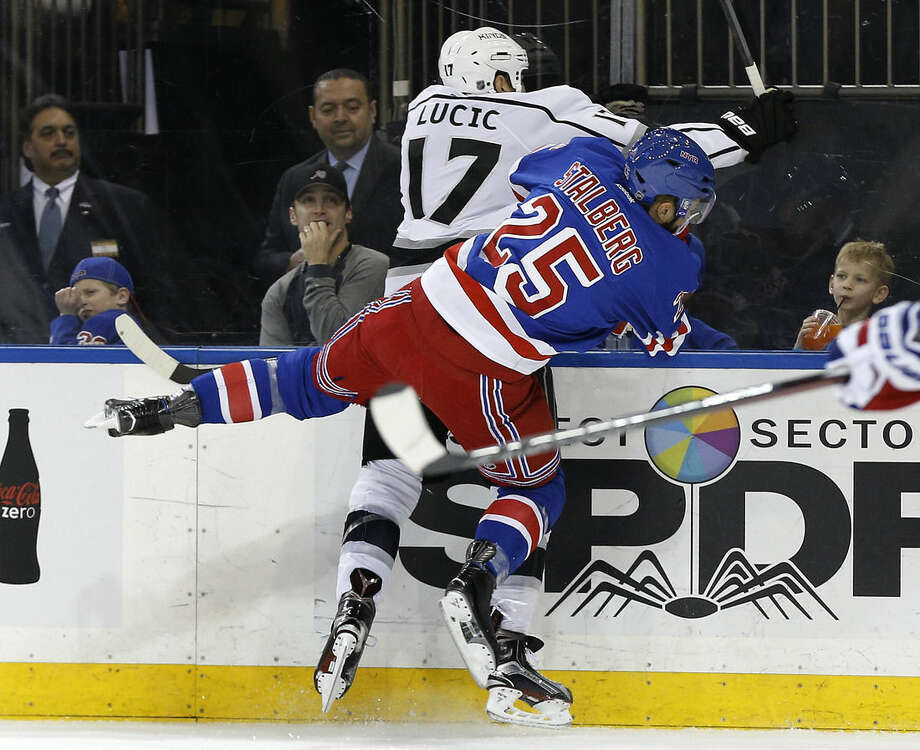 New York Rangers left wing Viktor Stalberg (25) collides with Los Angeles Kings left wing Milan Lucic (17) during the first period of an NHL hockey game, Friday, Feb. 12, 2016, in New York. (AP Photo/Julie Jacobson)