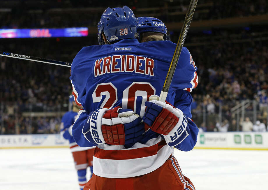 New York Rangers left wing Chris Kreider (20) celebrates with center Derek Stepan after Stepan scored a goal against the Los Angeles Kings during the second period of an NHL hockey game, Friday, Feb. 12, 2016, in New York. (AP Photo/Julie Jacobson)