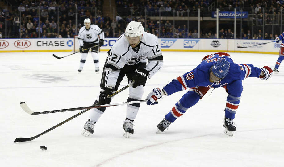 Los Angeles Kings center Trevor Lewis (22) controls the puck against New York Rangers defenseman Marc Staal (18) during the first period of an NHL hockey game, Friday, Feb. 12, 2016, in New York. (AP Photo/Julie Jacobson)