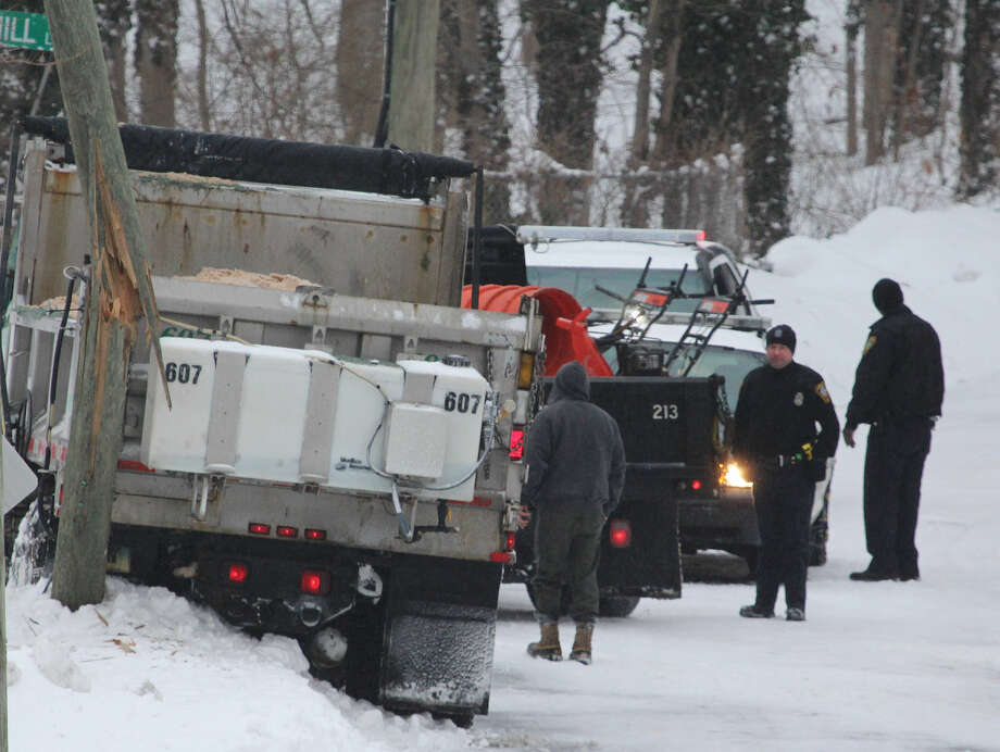 Hour photo/Chris Bosak A plow truck snapped a utility pole at the intersection of East Rocks Road and Brookhill Lane in Norwalk on Monday morning.