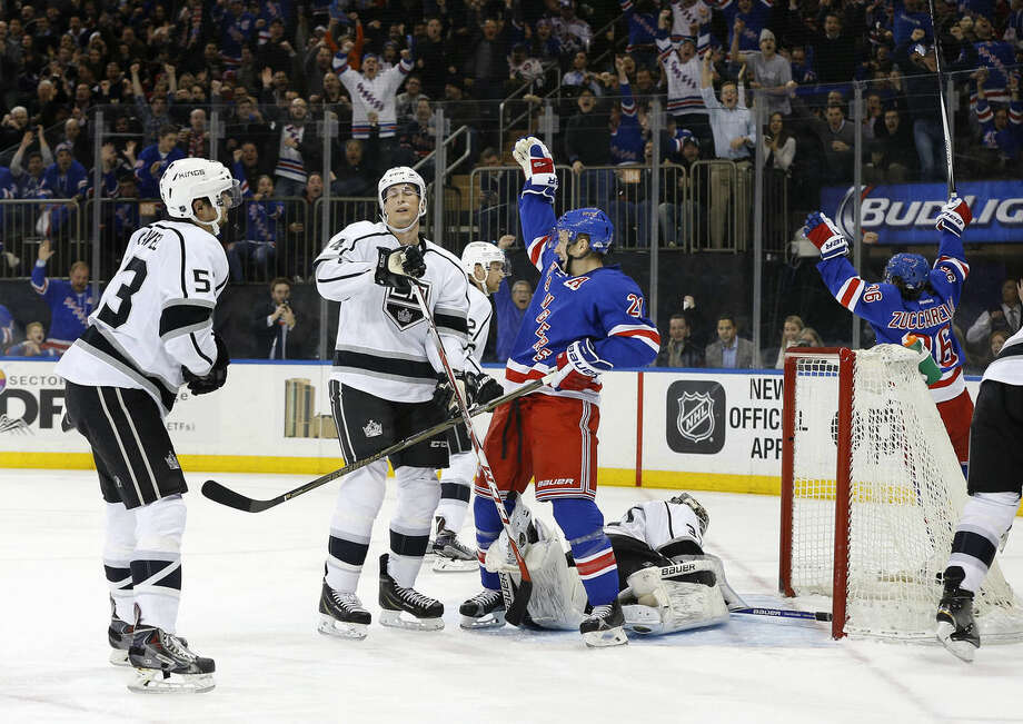 New York Rangers center Derek Stepan (21) reacts after 800right wing Mats Zuccarello (36) scored a goal against Los Angeles Kings goalie Peter Budaj (31) during the second period of an NHL hockey game, Friday, Feb. 12, 2016, in New York. Los Angeles Kings defenseman Kevin Gravel (53) and center Vincent Lecavalier (44) look on.(AP Photo/Julie Jacobson)