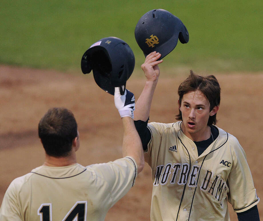 Cavan Biggio of Notre Dame gestures to teammate Kyle Richardson (14) after scoring against Incarnate Word during the Irish Baseball Classic, played at Wolff Stadium on Saturday, Feb. 22, 2014. Photo: Billy Calzada, Staff / San Antonio Express-News