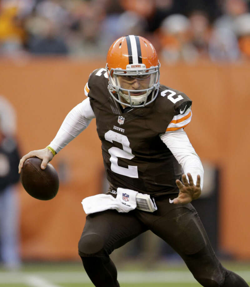 FILE - In this Sunday, Dec. 14, 2014, file photo, Cleveland Browns quarterback Johnny Manziel scrambles against the Cincinnati Bengals during an NFL football game, in Cleveland. An advisor for Manziel said in a statement released by the team Monday, Feb. 2, 2015, that Manziel has decided to enter treatment for an unspecified condition. (AP Photo/Tony Dejak, File)