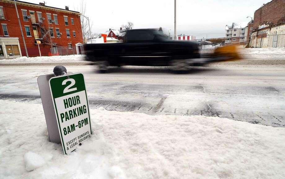 Hour Photo/Alex von Kleydorff Parking signs are almost buried in downtown Norwalk on Monday