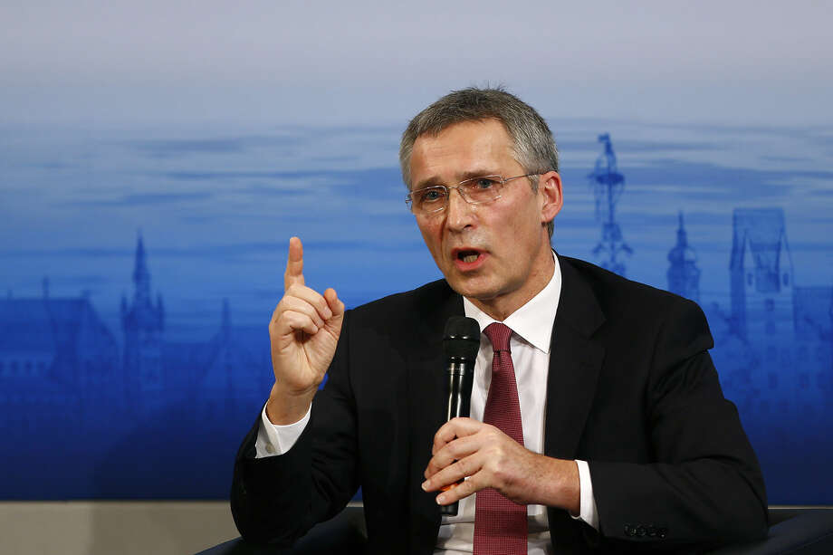 NATO Secretary General Jens Stoltenberg gestures during his speech at the Security Conference in Munich, Germany, Saturday, Feb. 13, 2016. (AP Photo/Matthias Schrader)