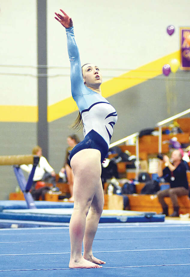 Hour photo/John Nash - Wilton's Sam Farhi performs on the floor exercise during Saturady's FCIAC gymnastics championship meet in Milford. Thanks to Farhi's performance on the floor - her first of the season - the Warriors finished third and on the podium in the chamionship meet.