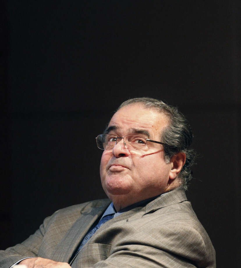FILE - In this Oct. 18, 2011 file photo, U.S. Supreme Court justice Antonin Scalia looks into the balcony before addressing the Chicago-Kent College Law justice in Chicago. A letter from the Supreme Court's doctor says Scalia suffered from coronary artery disease, obesity and diabetes, among other ailments that probably contributed to the justice's sudden death. (AP Photo/Charles Rex Arbogast, File)