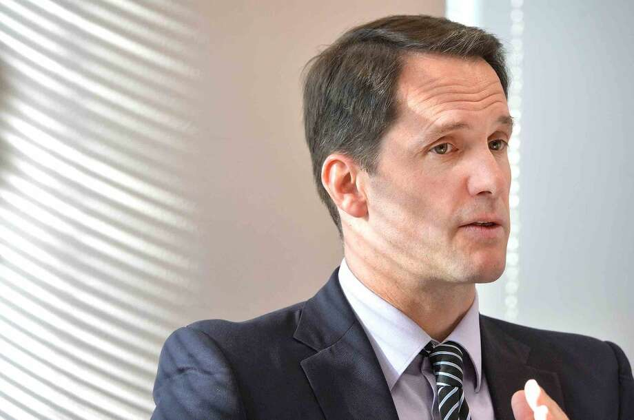 Congressman Jim Himes talks about Washington politics, world events and local issues during a media roundtable discussion at his Stamford office.