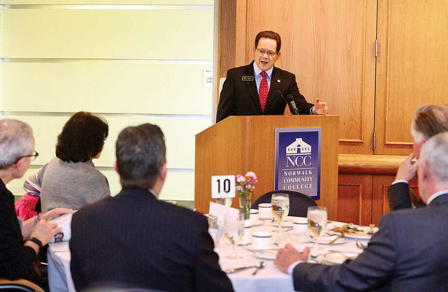 Hour photo / Erik Trautmann Norwalk Community College (NCC) President Dr. David Levinson discusses the need for increased funding for academic programs and student services during the NCC annual Legislative Breakfast Wednesday in the West Campus Culinary Arts Dining Roomw