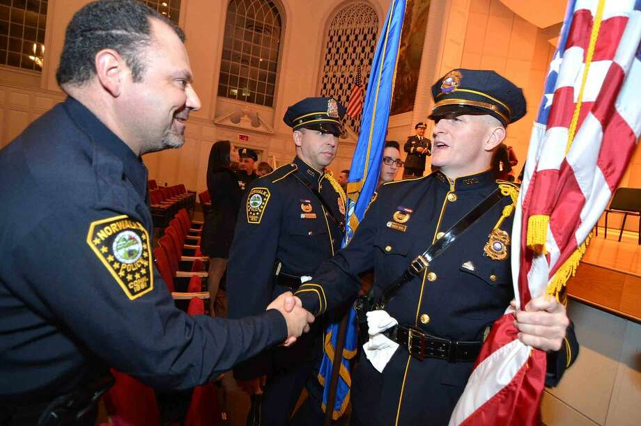 Hour Photo/Alex von Kleydorff Meritorious Commendation Award reciepient Police Officer David Nieves, thanks members of the NPD Color Guard at the departments Annual Awards Ceremony