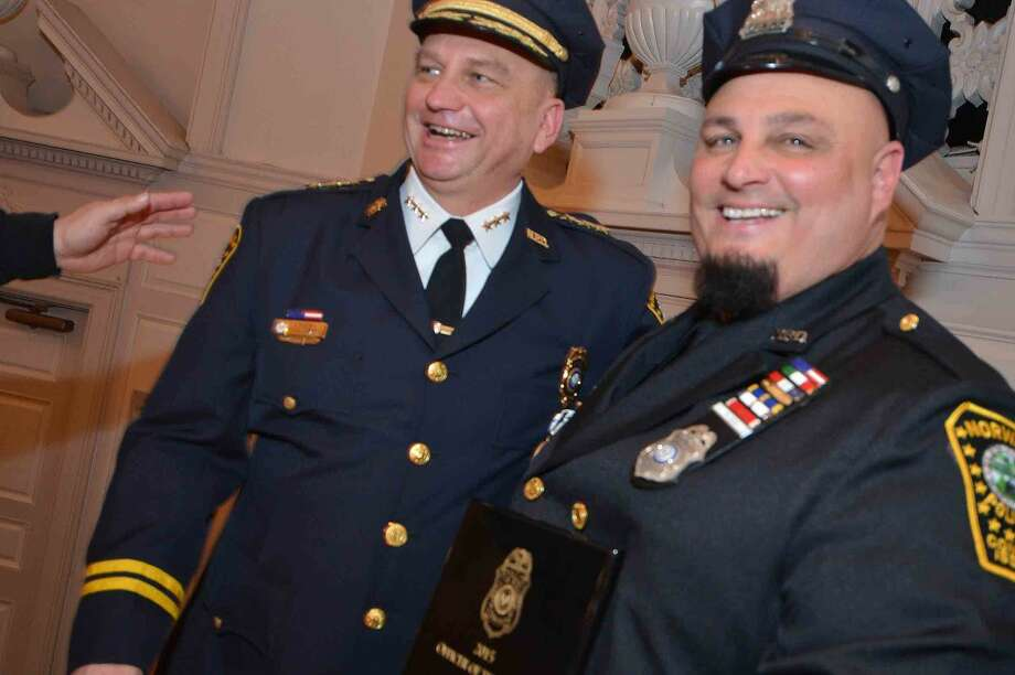 Hour Photo/Alex von Kleydorff Norwalk Police Chief Tom Kulhawik takes a moment with the 2015 Officer of the Year Mark Suda at the Annual Awards Ceremony at City hall