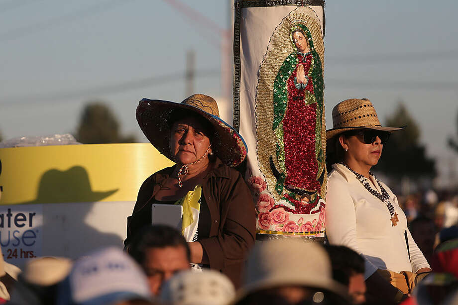 Women standing next to an image of the Virgin of Guadalupe listen to Pope Francis celebrate an outdoor Mass in Ciudad Juarez, Mexico, Wednesday, Feb. 17, 2016. Thousands of people from El Paso as well as other parts of the U.S. were expected to make the short trip over the various bridges that link the cities to attend the Mass that capped Francis' visit to the Latin American country. (AP Photo/Dario Lopez-Mills)