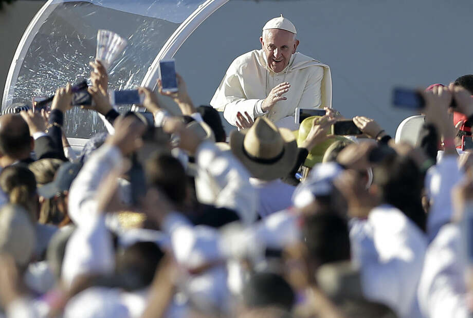 Pope Francis greets people as he arrives for an outdoor Mass at a field in Ciudad Juarez, Mexico, Wednesday, Feb. 17, 2016. Thousands of people from El Paso as well as other parts of the U.S. were expected to make the short trip over the various bridges that link the cities to attend the outdoor Mass that is expected to be attended by more than 200,000 people and will cap Francis' visit to the Latin American country. (AP Photo/Gregory Bull)