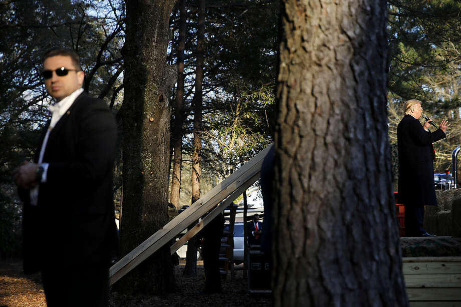 Republican presidential candidate Donald Trump, right, speaks during a campaign stop Wednesday, Feb. 17, 2016, in Walterboro, S.C. (AP Photo/Matt Rourke)