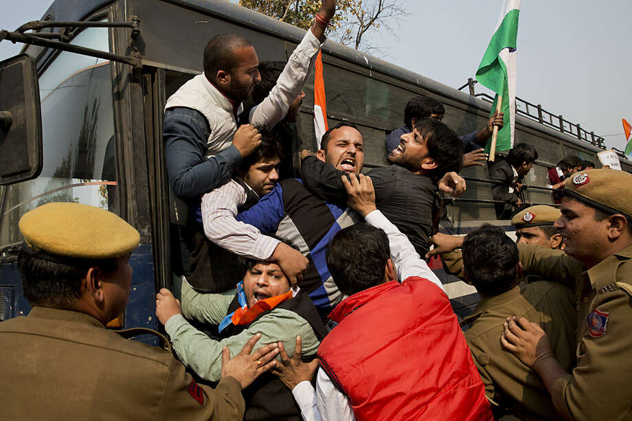 National Students Union of India members are detained by police during a protest by them in support of student leader Kanhaiya Kumar, in New Delhi, India, Wednesday, Feb. 17, 2016. Kumar, the president of the students' union at the country's premier Jawaharlal Nehru University has been in prison since Friday on charges of sedition. (AP Photo/Bernat Armangue)