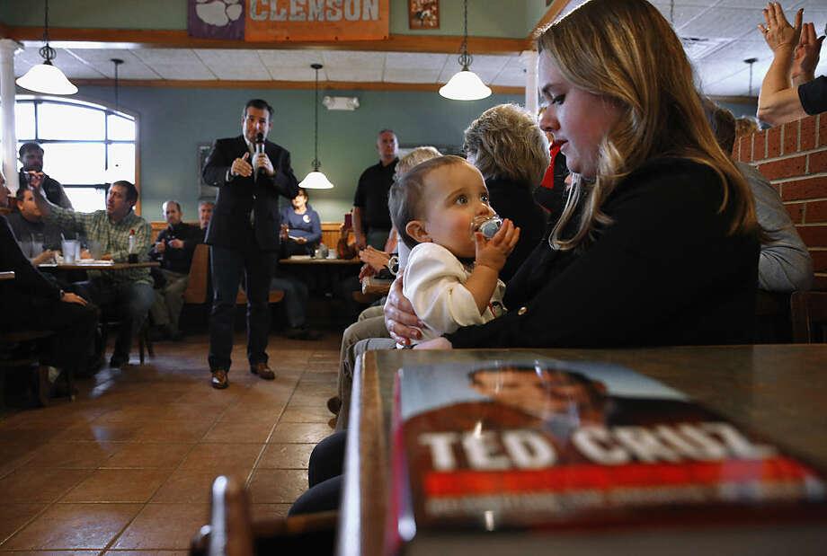 Republican presidential candidate, Sen. Ted Cruz, R-Texas speaks at the Seneca Family Restaurant as Kirsten Craft holds her daughter Reagan, 1, Tuesday, Feb. 16, 2016, in Seneca, S.C. (AP Photo/Paul Sancya)