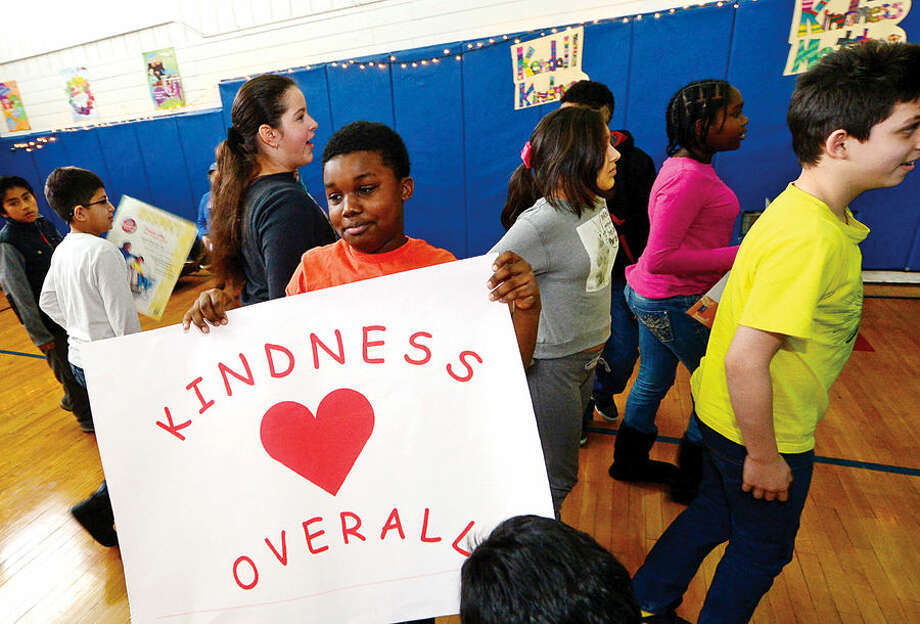 Hour photo / Erik Trautmann Kendall Elementary School 5th grader, Mikhail Moss, attends the school's Great Kindness Challenge assembly Tuesday that culminated a week of events that are part of Kendall's anti-bullying and positive citizenship program.