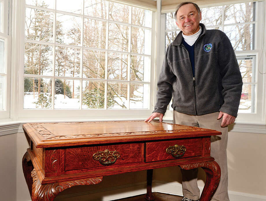 Hour photo / Erik Trautmann Hour photo / Erik Trautmann Owner of Joseph A. Marino Contractors, Lew Marino, with a desk given to his fther by the family of US Senator Brie=n McMahon. The company is celebrating their 75th anniversary this year.