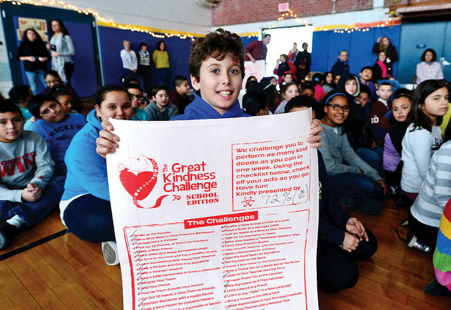 Hour photo / Erik Trautmann Kendall Elementary School 5th grader, Dimitri Tiktapanidis, attends the school's Great Kindness Challenge assembly Tuesday that culminated a week of events that are part of Kendall's anti-bullying and positive citizenship work.