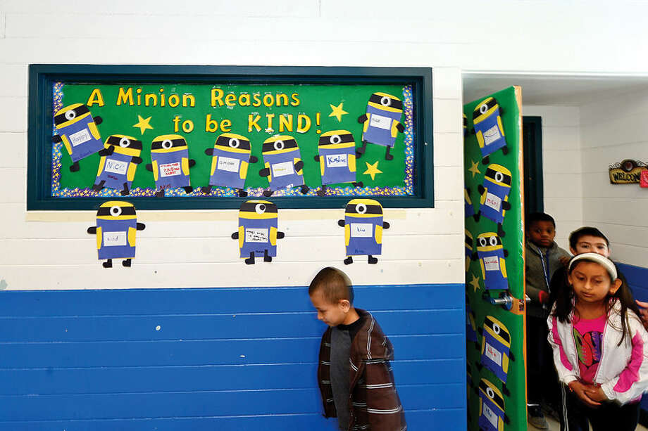 Hour photo / Erik Trautmann Students from Kristen Rubush's 2nd grade class exit in front of the class's The Great Kindness Challenge display that is part of Kendall Elementary School's anti-bullying and positive citizenship program.