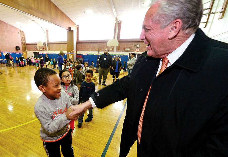 Hour photo / Erik Trautmann Kendall Elementary School students line up to shake the hand of Norwalk mayor, Harry Rilling, following the school's Great Kindness Challenge assembly Tuesday that culminated a week of events that are part of Kendall's anti-bullying and positive citizenship program.