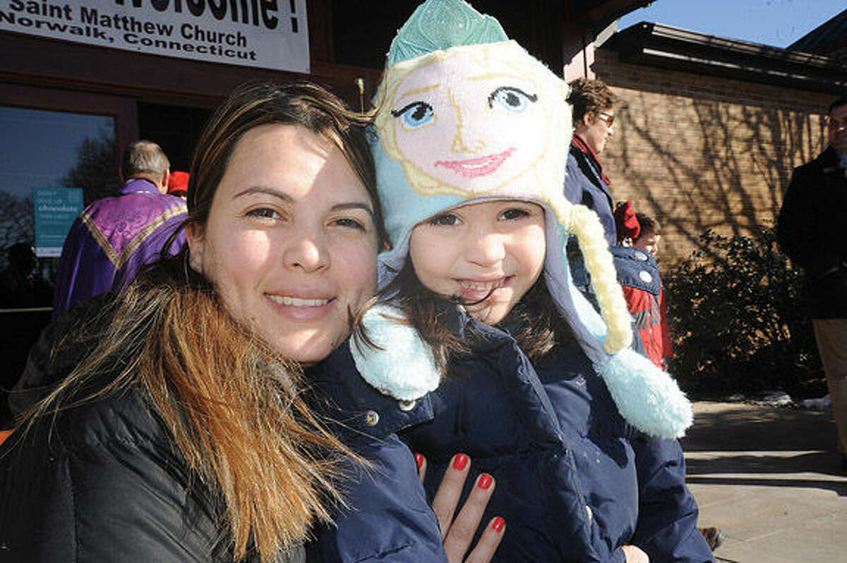 Karen Guerrero and her daughter Mia Alvarado 5, brave the cold weather Sunday morning in West Norwalk after church service at St. Matthew Church. Hour photo/Matthew Vinci