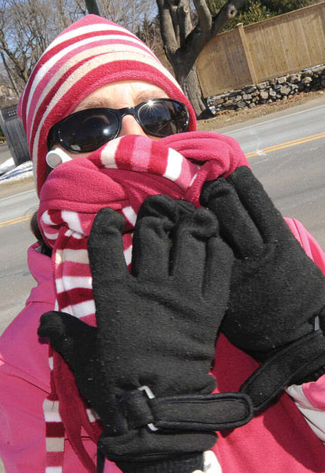 Meryl Kaplan takes a cold stroll down Compo Road South in Westport on Sunday. Hour photo/Matthew Vinci