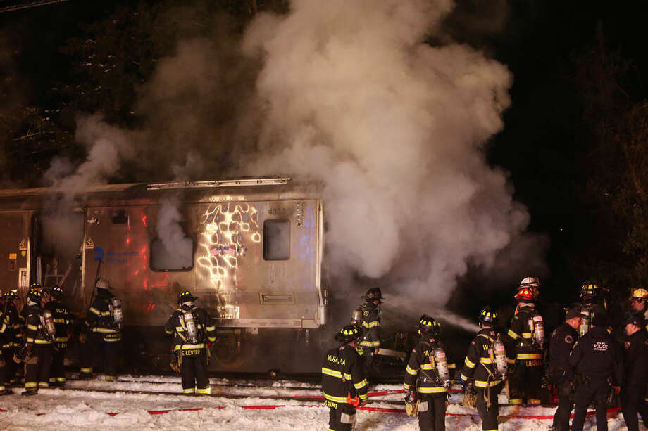 Firefighters work the scene of a collision between a Metro-North Railroad passenger train and two vehicles in Valhalla, N.Y., Tuesday, Feb. 3, 2015. (AP Photo/The Journal-News, Frank Becerra, Jr.) NYC METRO OUT, TV OUT, MAGS OUT, NO SALES