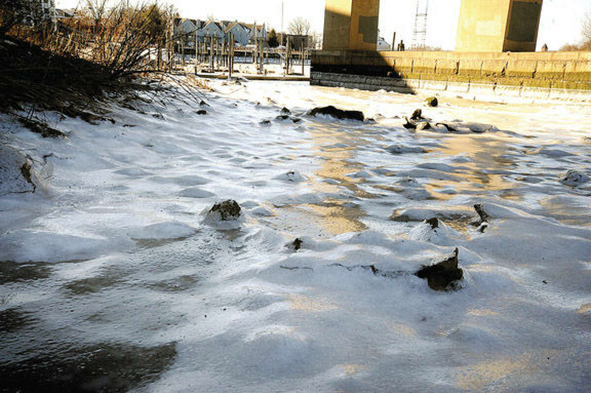 A frozen shoreline under the I-95 bridge in Norwalk as record cold temperatures are registered Sunday all across the area. Hour photo/Matthew Vinci