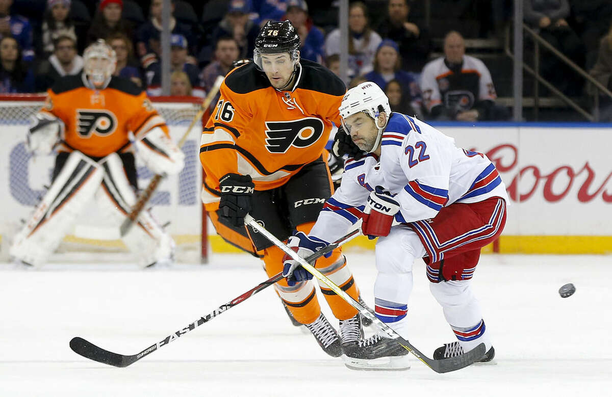 Philadelphia Flyers center Chris VandeVelde (76) passes off the puck against New York Rangers defenseman Dan Boyle (22) during the first period of an NHL hockey game, Sunday, Feb. 14, 2016, in New York. (AP Photo/Julie Jacobson)
