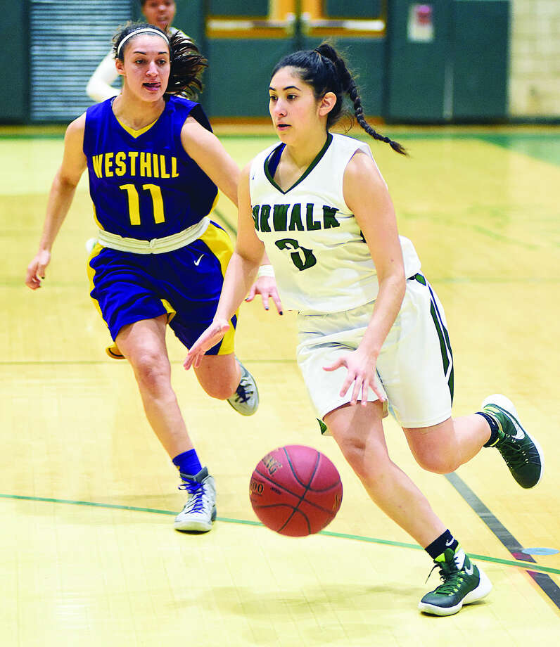 "Norwalk High School senior guard Chelseay Cerrato, right, races to the hoop to score the game-opening basket off the opening tip-off during Tuesday afternoon's 65-37 girls FCIAC win over Westhill at Scarso Gym. Due to injuries, Cerrato was the only one of the Bears' three seniors who got to play in the ""Senior Night"" contest."
