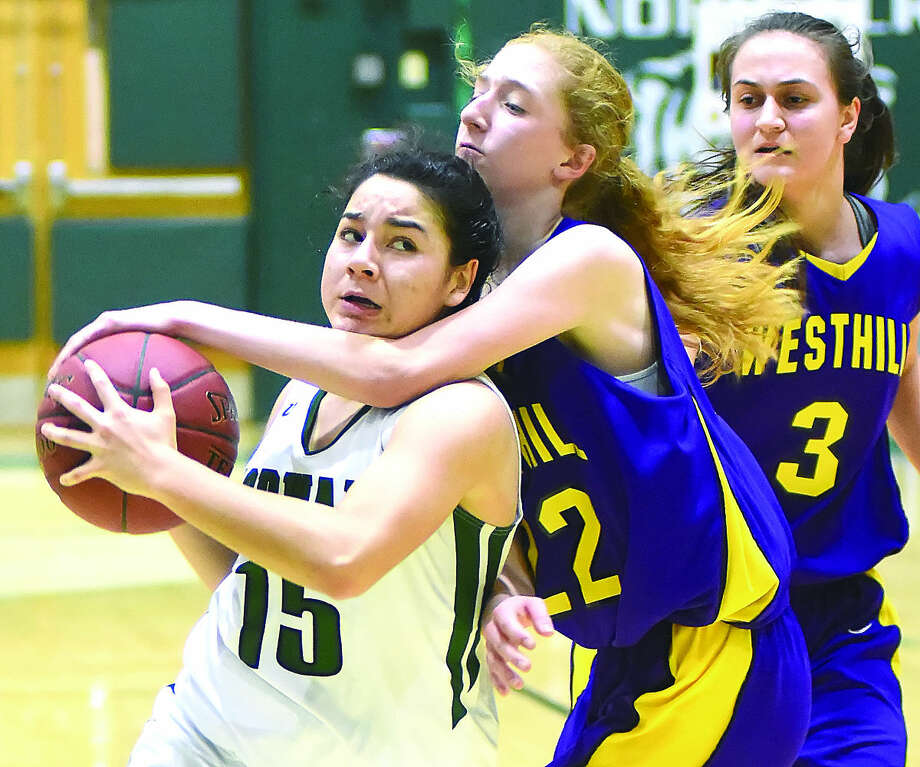 Norwalk's Tatiana Arias gets fouled while going up for a shot against Westhill on Tuesday. Norwalk won 65-37.