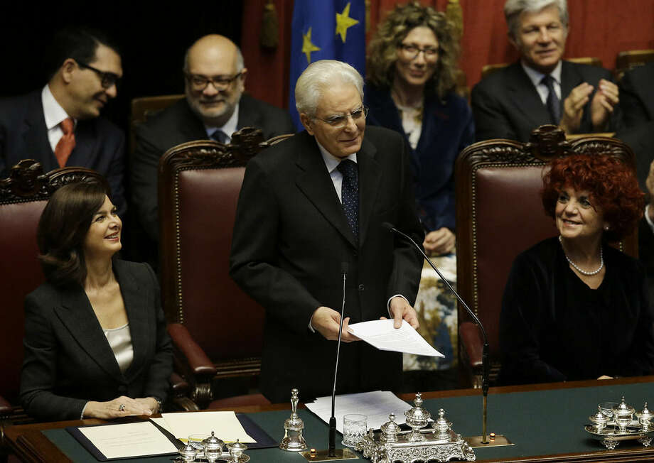 Newly elected Italian President Sergio Mattarella, center, flanked by Lower Chamber President Laura Boldrini, left, and vice-president of Italian Senate Valeria Fedeli, right, delivers his speech during his swearing-in ceremony at the Lower Chamber in Rome, Tuesday, Feb. 3, 2015. Sergio Mattarella on Monday resigned from his post as constitutional judge, a day before his swearing-in ceremony. Mattarella, 73, was elected as the new president on Saturday, in the fourth round of balloting held by Italian parliament in joint session. (AP Photo/Gregorio Borgia)