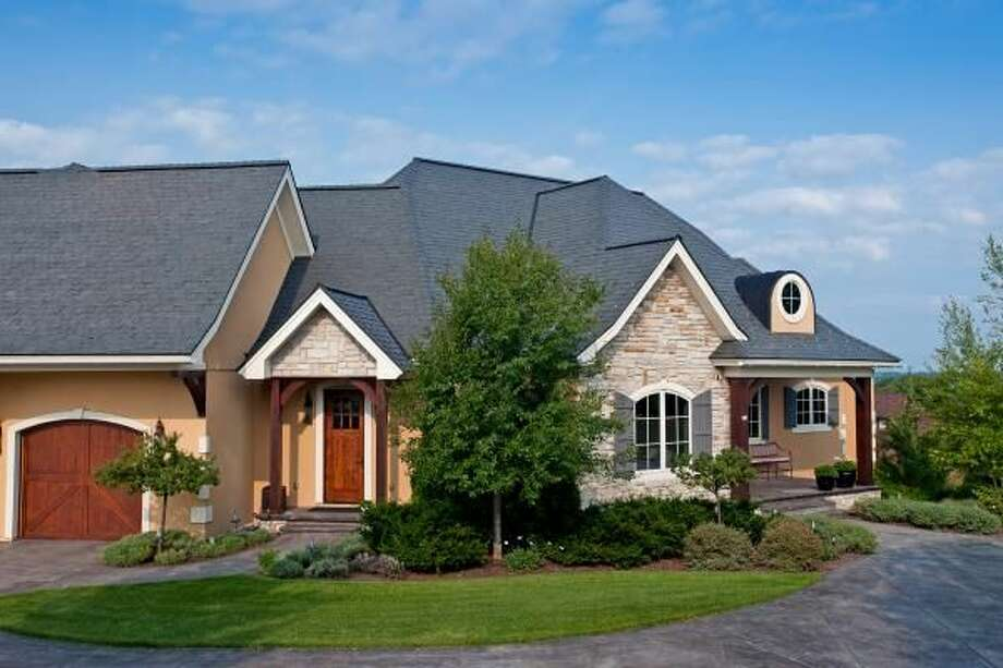 Polymer slate and shake roofing tiles add beauty and durability to a home.