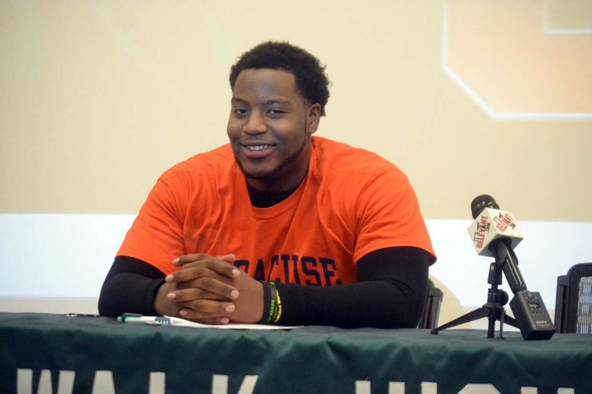 Norwalk's Evan Adams signed his National Letter of Intent to play football at Syracuse University. (Pete Paguaga/Hour photo