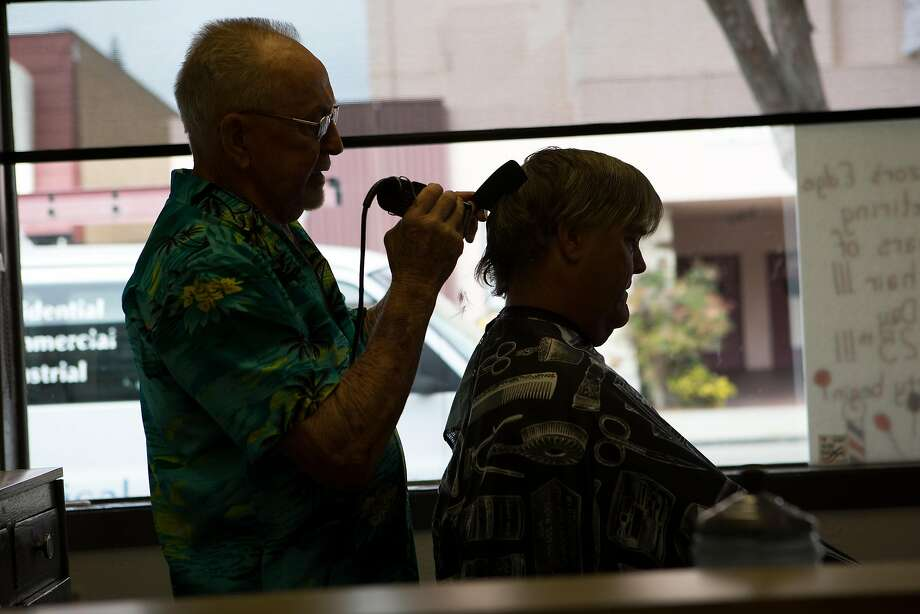 Longtime barber Dick Kellogg cuts Brad Clerk's hair at his Alameda barber shop on Thursday, June 9, 2016. Kellogg is retiring this month after cutting hair 63 years. Photo: Amy Osborne, Special To The Chronicle