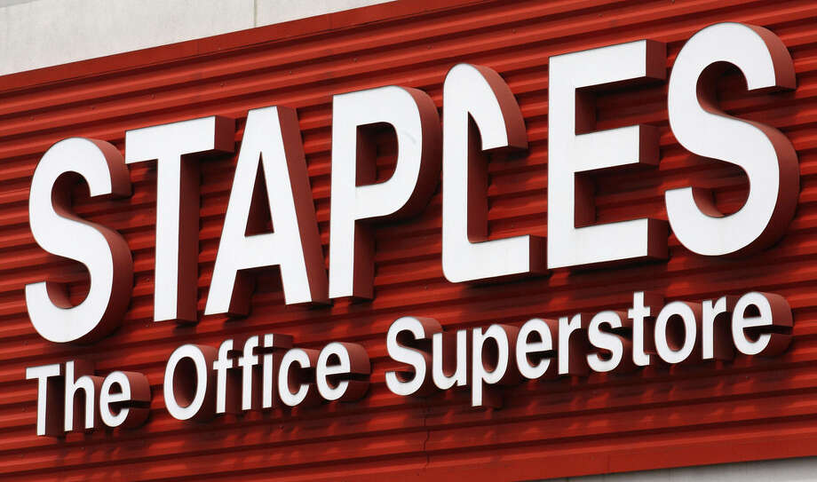FILE - In this May 17, 2011 file photo, a Staples sign is displayed on the front of a Staple store, in Portland, Ore. Staples is buying Office Depot in a cash-and-stock deal valued at nearly $6 billion. Office Depot Inc. shareholders will receive $7.25 in cash and 0.2188 of a share in Staples Inc. at closing. The deal values Office Depot at $11 per share. (AP Photo/Rick Bowmer, File)