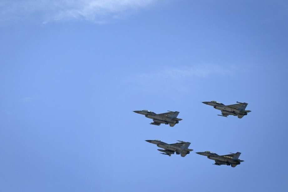 Jordanian Air Force fighter jets fly during the funeral of slain Jordanian pilot, Lt. Muath al-Kaseasbeh, at his home village of Ai, near Karak, Jordan, Wednesday, Feb. 4, 2015. Outrage and condemnation poured across the Middle East on Wednesday as horrified people learned of the video purportedly showing the Islamic State group burn a Jordanian pilot to death. (AP Photo/Nasser Nasser)