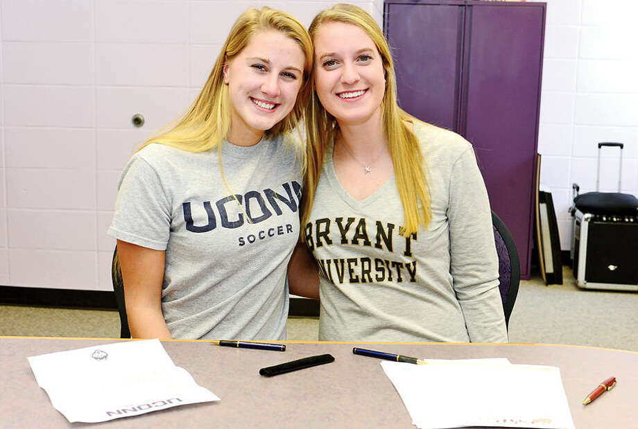 Hour photo / Erik Trautmann Westhill High School girls soccer players Heidi Druehl and Rachel Benz who signing Nation Letters on Intent for D-1 schools UConn and Bryant respectively.