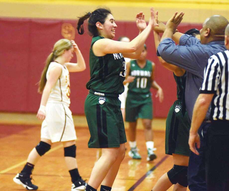 Hour photo/John Nash - Norwalk's Chelsey Cerrato, center high fives coach Ricky Fuller after the final buzzer sounded in the Bears' 48-44 FCIAC girls basketball win in Trumbull. The win clinched the No. 8 seed for Saturday's league quarterfinals.