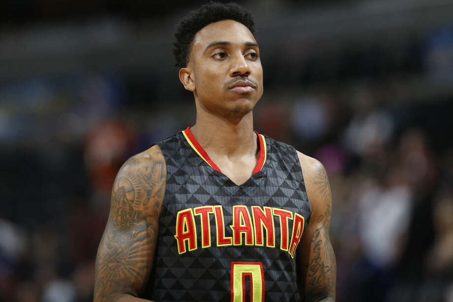 FILE - In this Jan. 25, 2016, file photo, Atlanta Hawks guard Jeff Teague (0) looks on during the first half of an NBA basketball game against Denver, in Denver. The Hawks could look to shake things up and give themselves a boost while sitting in the fourth spot in the Eastern Conference. With backup point guard Dennis Schroder showing promise, moving Teague could bring some defensive help in the frontcourt after the Hawks lost big man Tiago Splitter for the season to a hip injury.(AP Photo/David Zalubowski, File)