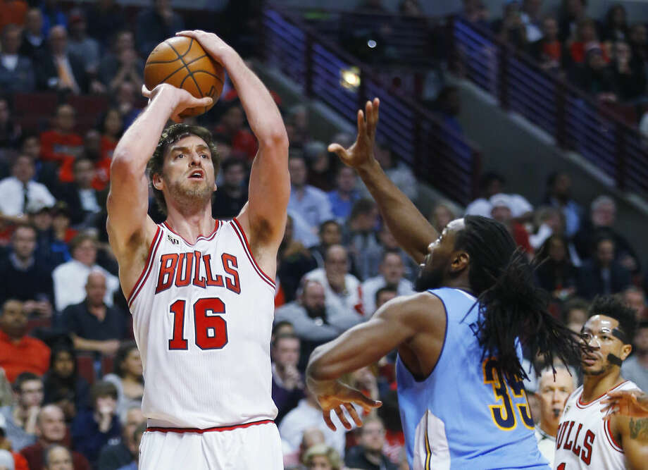 FILE - In this Dec. 2, 2015, file photo, Chicago Bulls center Pau Gasol (16) shoots over Denver Nuggets forward Kenneth Faried (35) during the second half of an NBA basketball game, in Chicago. The Bulls All-Star is one of the most skilled big men in the league. But the 35-year-old also can become a free agent in July, and the Bulls could look to get some compensation for him. (AP Photo/Jeff Haynes, File)