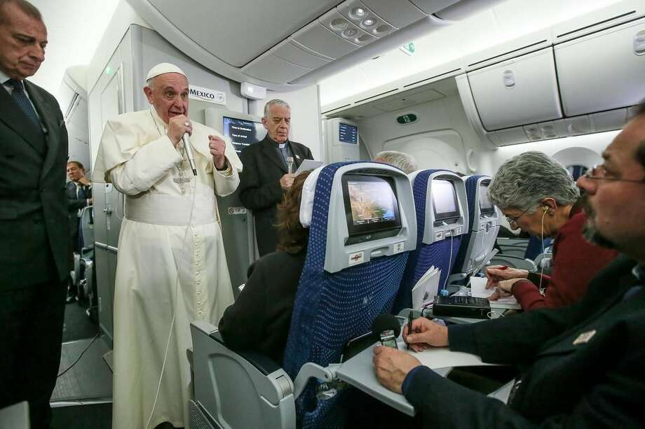 In this photo taken Wednesday, Feb. 17, 2016 Pope Francis meets journalists aboard the plane during the flight from Ciudad Juarez, Mexico to Rome, Italy. The pope has suggested that women threatened with the Zika virus could use artificial contraception but not abort their fetus, saying there's a clear moral difference between aborting a fetus and preventing a pregnancy. (Alessandro Di Meo/Pool Photo via AP)
