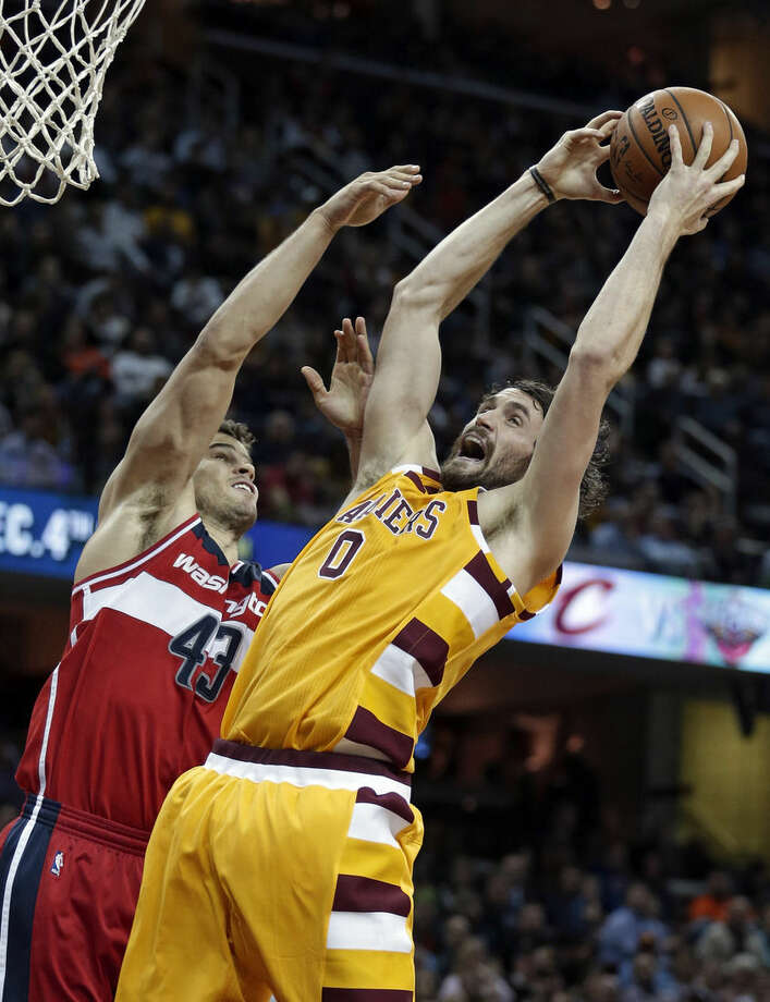 FILE - In this Dec. 1, 2015, file photo, Cleveland Cavaliers' Kevin Love (0) grabs a rebound ahead of Washington Wizards' Kris Humphries (43) in the second half of an NBA basketball game, Cleveland. The Cleveland forward has heard his name in trade rumors for much of the season. (AP Photo/Tony Dejak, File)