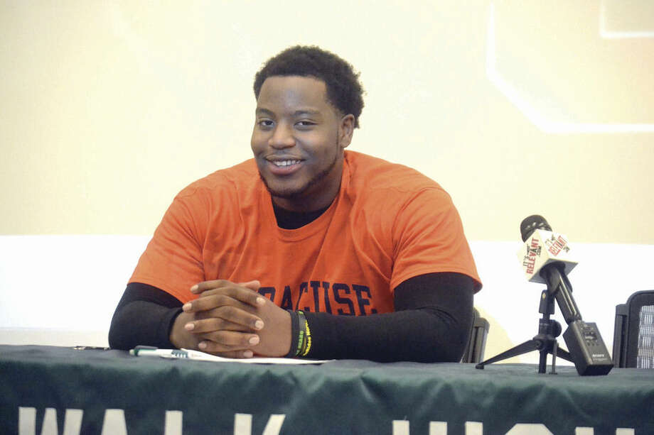 Hour photo/Pete PaguagaNorwalk's Evan Adams signed his National Letter of Intent to play football at Syracuse University on Wednesday at Norwalk H.S.