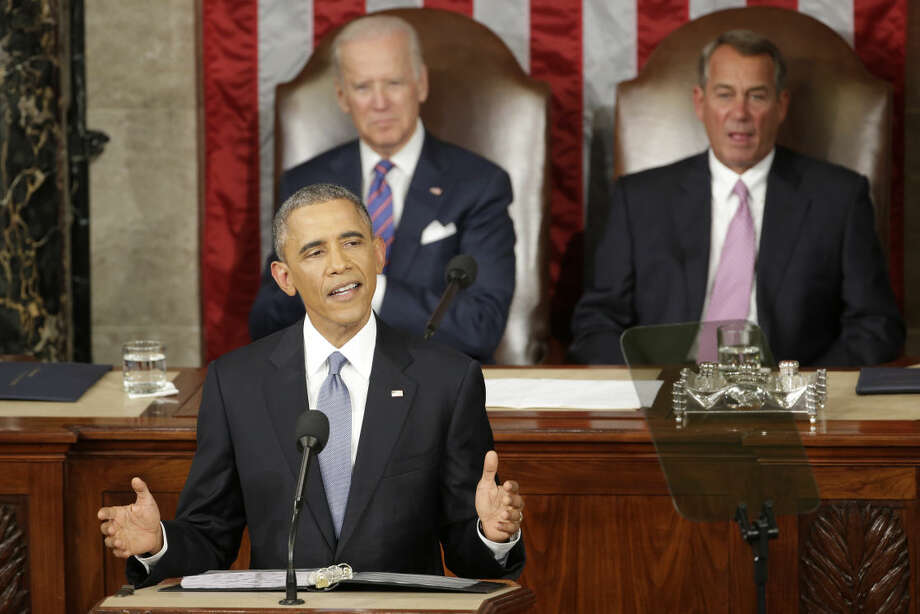 FILE - In this Jan. 20, 2015 file photo, President Barack Obama gives his State of the Union address before a joint session of Congress on Capitol Hill in Washington as Vice Presient Joe Biden and House Speaker John Boehner of Ohio listen. Out of time to push a new legislative agenda, a battle-hardened President Barack Obama will look straight past Congress and to the American people in his final State of the Union address, aiming to define his presidency and his legacy before others can do it for him. (AP Photo/J. Scott Applewhite)