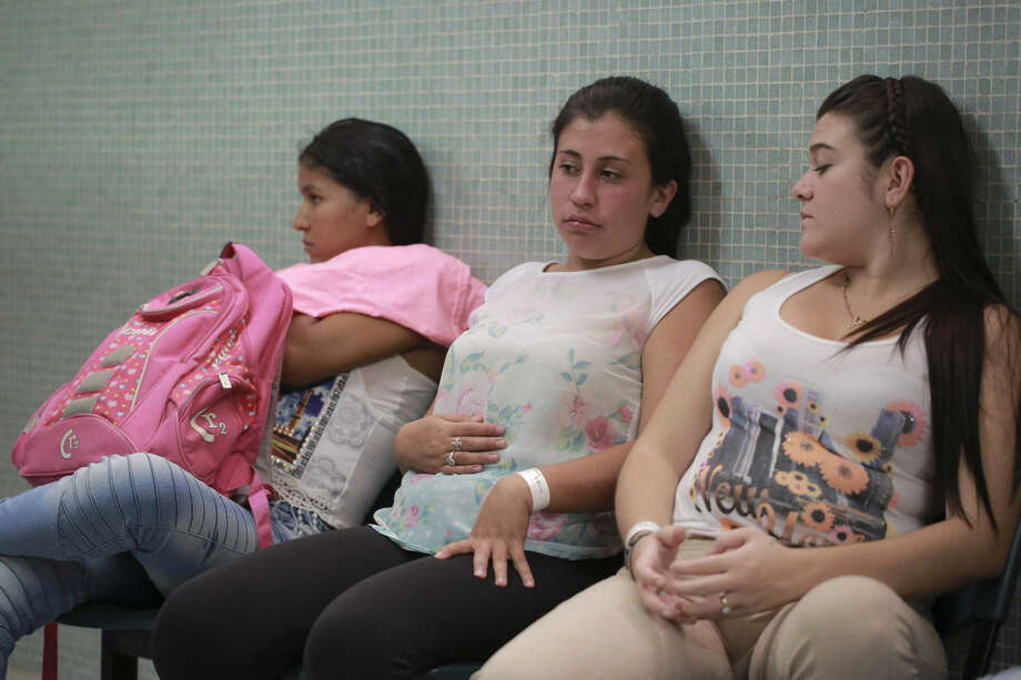 FILE - In this Thursday, Feb. 11, 2016 file photo, Daniela Rodriguez, 19, six-weeks pregnant, sits between two other women who are expecting, as they wait for test results after being diagnosed with the Zika virus at the Erasmo Meoz Hospital in Cucuta, Colombia. Scientists suspect an outbreak of the Zika virus is behind a surge in a rare birth defect in Brazil. But how are they going to prove it? Authorities in the South American country were quick to make the link last fall. But experts say the evidence is still circumstantial. Experts say it will take a combination of studies and laboratory evidence to finally determine if Zika is the villain it appears to be. (AP Photo/Ricardo Mazalan)