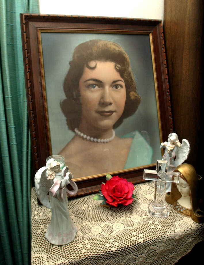 This photo taken on March 11, 2004, shows a portrait of Irene Garza displayed at the home of her aunt Herlynda De La Vina in Edinburg, Texas. A former priest was arrested Tuesday, Feb. 9, 2016, in Arizona in the 1960 slaying of the 25-year-old Texas schoolteacher and beauty queen. (Delcia Lopez /The San Antonio Express-News via AP) RUMBO DE SAN ANTONIO OUT; NO SALES; MANDATORY CREDIT