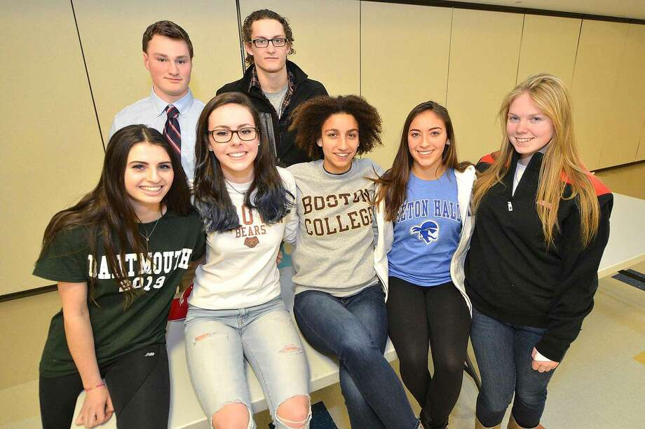 From left the right front: Olivia Wiener, Bridget Van Dorsten, Erica Hefnawy, Lauren Garcia, Maggie Walsh. Back: Ian Burns and Nicolaas Esposito will all be continuing their athletic careers at the next level. (Alex von Kleydorrf/Hour photo)